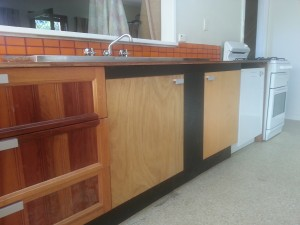 Gaps created by combing reused kitchen components filled with black border