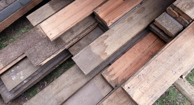 Stack of recycled timber showing a variety of colours