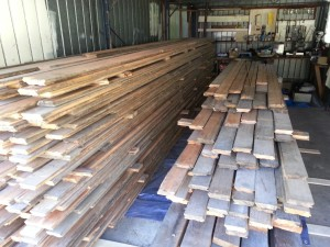 Recycled floorboards delivery safely stacked in the garage.