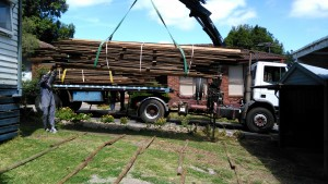 Recycled floorboards being lifted off the truck.