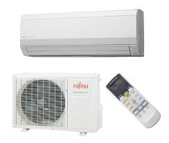 Reverse cycle air conditioner for heating and cooling