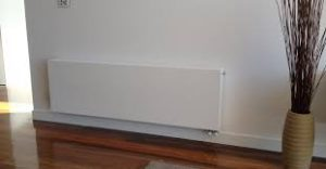 Wall panels for a hydronic heating system