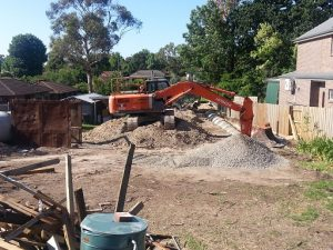 Excavation to install new drain lines