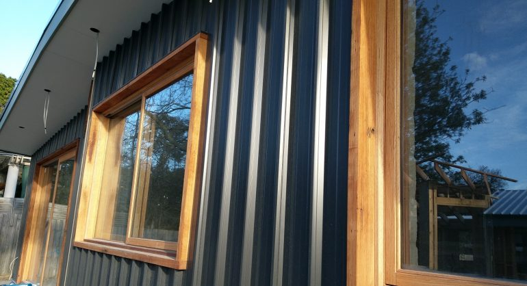 Steel cladding contrasts well with timber door and window frames